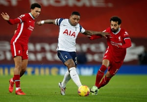 Bergwijn of Tottenham battles for possession with Salah and Alexander-Arnold.