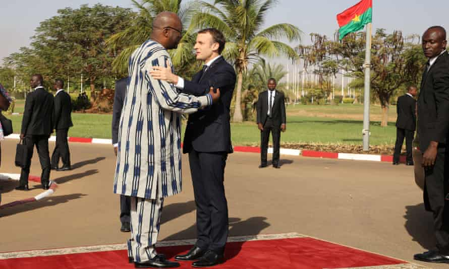President Roch Marc Christian Kabore welcomes Emmanuel Macron to the presidential palace in Burkina Faso.