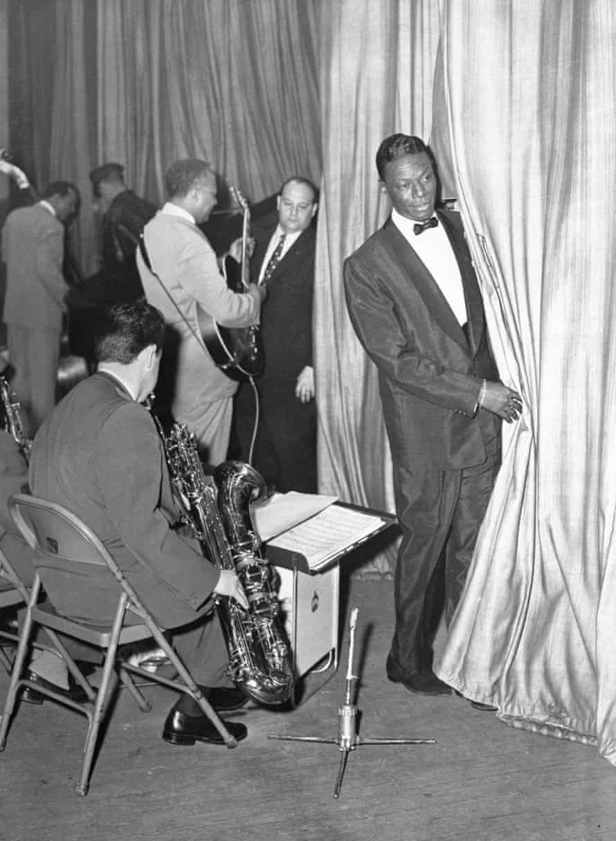 """Nat """"King"""" Cole on stage after being attacked, 10 April 1956."""