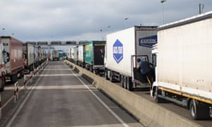 Lorries wait to board a freight train in Calais in 2018