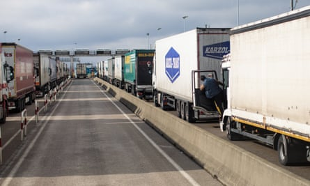 Lorries wait to board a freight train in Calais.