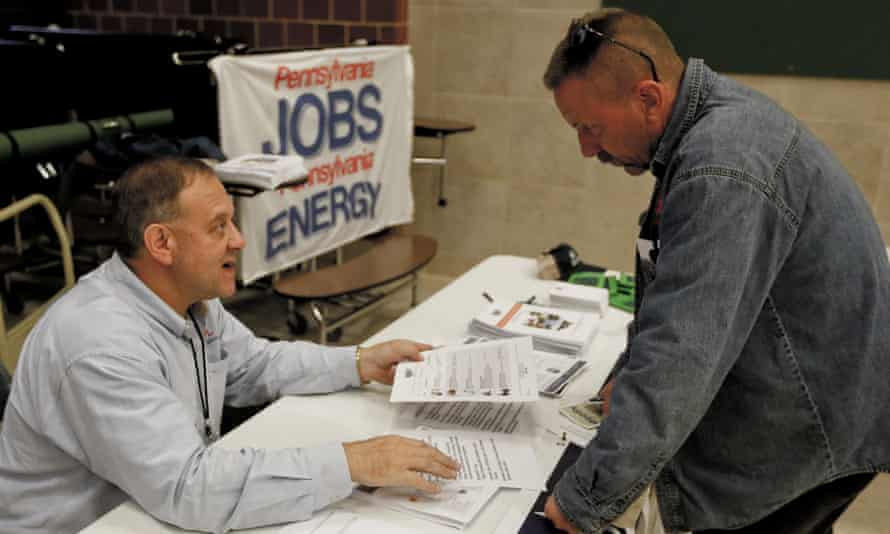 A recruiter in the shale gas industry speaks with an attendee of a job fair in Cheswick, Pennsylvania.