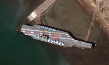 Satellite image of Iran's refurbished mockup aircraft carrier in the Strait of Hormuz
