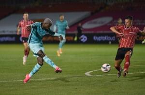 Divock Origi fires home Liverpool's seventh.