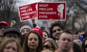Anti-abortion marchers carry signs describing Donald Trump as 'Most pro-life president. Ever.'