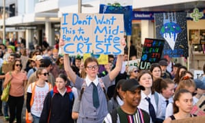Students hold placards during a strike to raise climate change awareness in Christchurch, New Zealand.