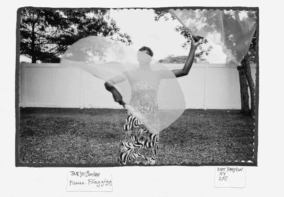 Taryn Booker practicing a spiritual ceremony called praise flagging, East Hampton, New York, 2011