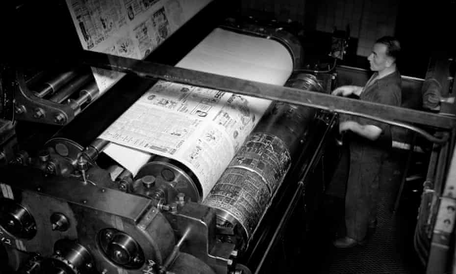 A printer watches over a newspaper press in 1935.