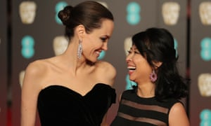 Angelina Jolie with Cambodian-born US writer and producer Loung Ung on the red carpet upon arrival at the Baftas.
