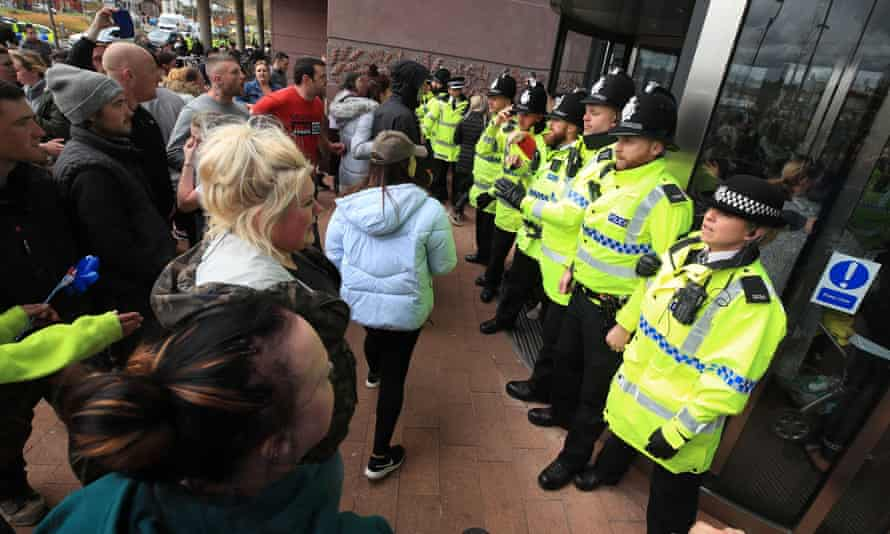 Protesters and police at Alder Hey children's hospital, Liverpool, on 23 April.