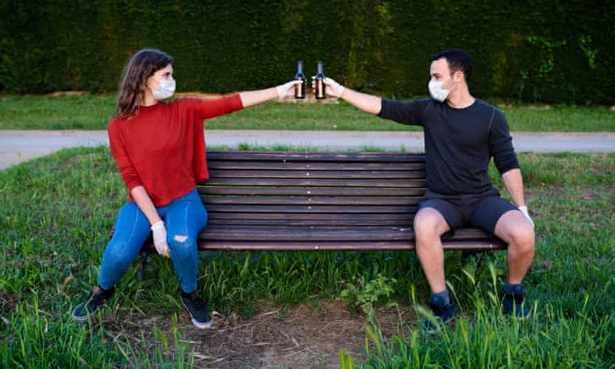A man and a woman on a park bench