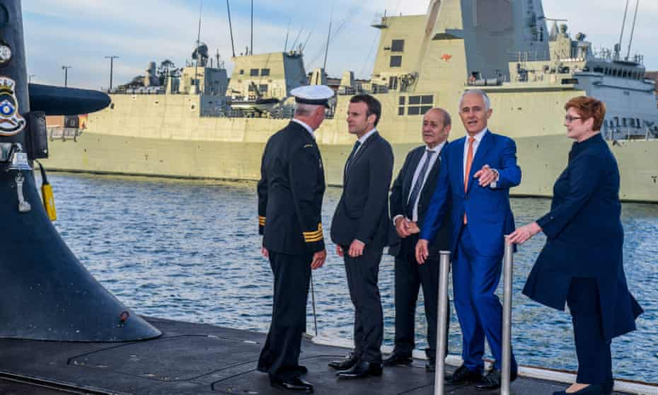 Emmanuel Macron, second left, in 2018 with the then Australian Prime Minister, Malcolm Turnbull,  second right, on a  submarine in Sydney.