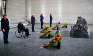 Angela Merkel with the president of the Bundestag, Wolfgang Schaeuble, and the German president, Frank-Walter Steinmeier