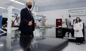 Donald Trump tours a phamaceutical plant where components for a potential Covid -19 vaccine are being developed.