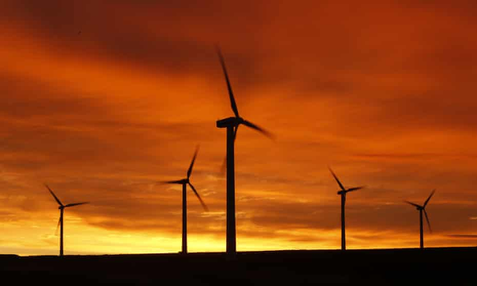wind turbines pictured at dusk