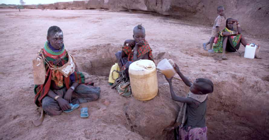 A child fetches water from a shallow well in Nanam, Turkana.