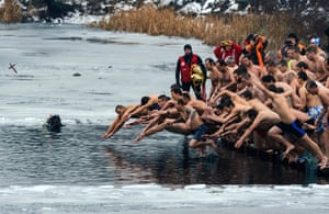 Bulgarians plunge into the icy winter water of a lake in Sofia to try to catch a cross