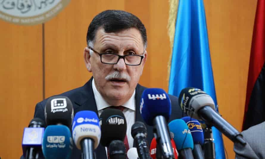 Fayez al-Sarraj speaks at a press conference in Tripoli.
