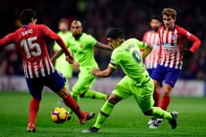 Barcelona's Luis Suarez and Atletico Madrid's Montenegrin Stefan Savic tussle for the ball.