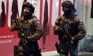 Police officers are seen at London Bridge on Saturday night.