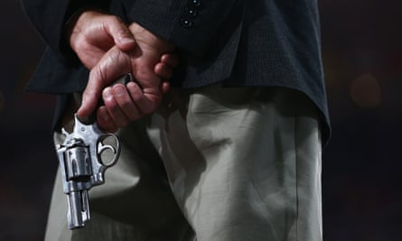 An Olympic official holds a starting pistol, London, 2012