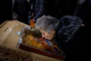 Gusterica, Kosovo. An ethnic Serb woman kisses an icon as she attends the Orthodox Christmas liturgy at Prince Lazar church. Orthodox Serbs are celebrating Christmas on 7 January, according to the old Julian calendar