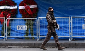 A Turkish police officer patrols at the Reina nightclub in Istanbul, three days after a gunman killed 39 people. Abdurakhmon Uzbeki, who was linked to the attack, has been killed by US forces in Syria.