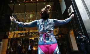 Singer Gigi Love protests outside Trump Tower in New York.