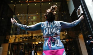A woman protests against climate change outside the Trump Tower in New York.