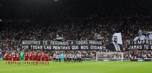 Newcastle and Liverpool players during a minutes applause as a mark of respect for former chairman Freddy Shepherd before kick off in the 1-1 draw at St James' Park.
