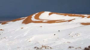 People play on the snowy dunes