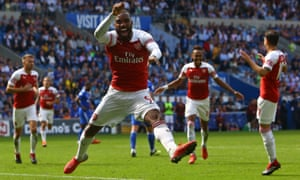 Alexandre Lacazette celebrates after Arsenal's second goal scored by Pierre-Emerick Aubameyang (second right) against Cardiff.