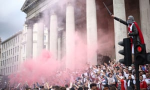 Fans and flares in London's Trafalgar Square.