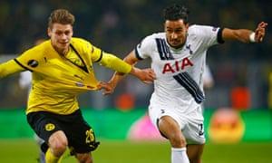 Borussia Dortmund's Lukasz Piszczek bgets a tug from Nacer Chadli.