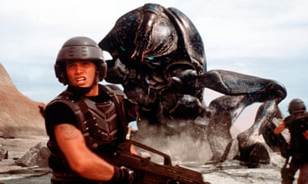 Johnny Rico, played by Casper Van Dien, tackles an alien bug in Starship Troopers