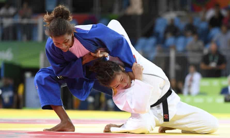 Silva (L) competes against Sumiya Dorjsuren of Mongoli