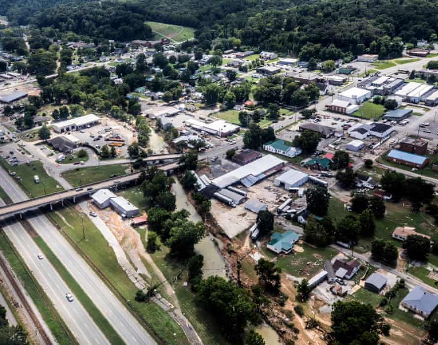 Flood-damaged areas are seen from a helicopter flown by the Tennessee national guard in Waverly.