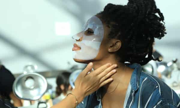 A model in a Dr Jart+ sheet mask backstage at New York fashion week.