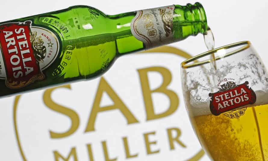 Stella Artois being poured in front of SAB Miller sign