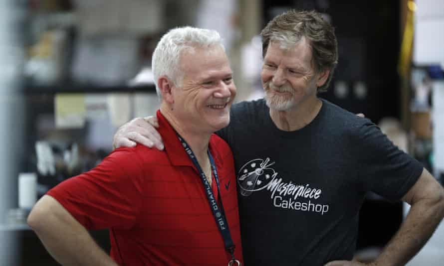 Jack Phillips and a customer at the Masterpiece Cakeshop in Colorado on Monday. The supreme court ruled that Phillips' religious beliefs did not violate Colorado's anti-discrimination law.