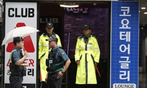 Police stand outside a nightclub in Gwangju on Saturday after a fatal balcony collapse