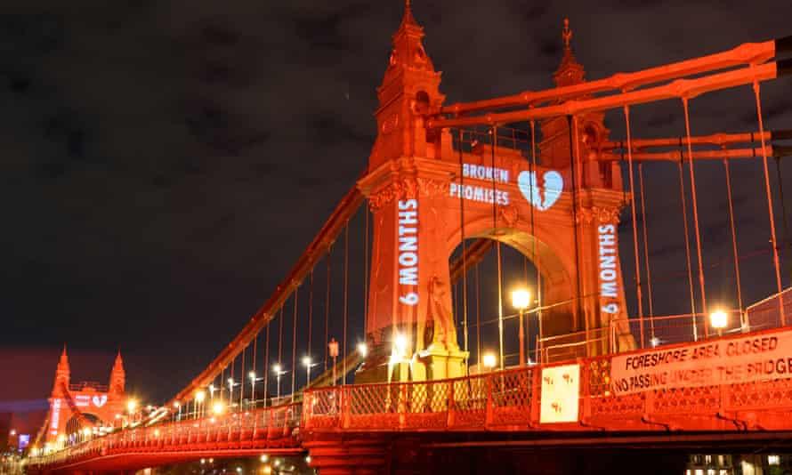 Hammersmith Bridge illuminated bright red in a Valentine's Day stunt