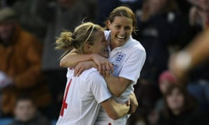 Kelly Smith celebrates with goal scorer Katie Chapman during the Women's World Cup Qualifier match against Spain at the New Den in London