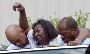 Frances Sanders, mother of Jonathan Sanders, is helped to a waiting car after her son's funeral service on Saturday at the Family Life church in Quitman, Mississippi.