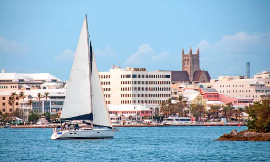 A boat sails into the harbour in Hamilton, Bermuda