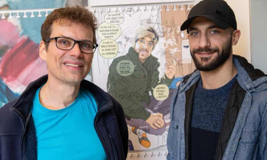 The llustrator Olivier Kugler (left) with Syrian refugee Ammar Raad, who is depicted in Olivier's artwork behind them.