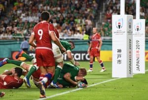 Ireland's Rhys Ruddock scores their third try.