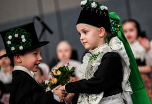 Children dressed as groom and bride during the Ptaci Kwas celebrations