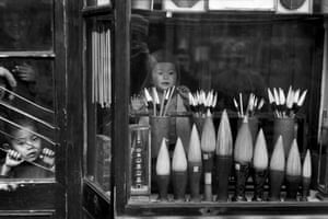 The window display of a brush merchant in the antique dealers' street, Beijing, December 1948The 10 months Cartier-Bresson spent in China in 1948-49 saw the fall of the Kuomintang (Nationalist) government and the emergence of the People's Republic of China