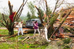 Debris is scattered in the front yard of a damaged home, after several tornadoes reportedly touched down, in Linwood, Kansas